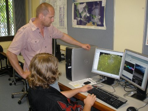Stephan Maier working with student Grant Thiel on the GIS remote sensing software